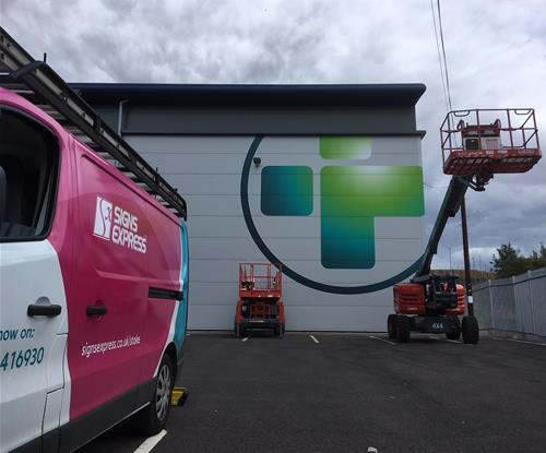 Reliance Medical Logo being Erected by Signs Express Stoke