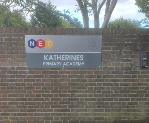 Wall mounted school entrance sign